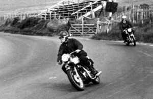 Isle of man, United Kingdom: wearing black leather racing gear, Lord Snowdon, husband