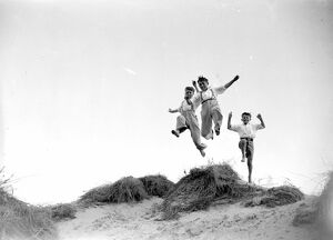 Jumping for joy at Camber Sands in Sussex. 1934