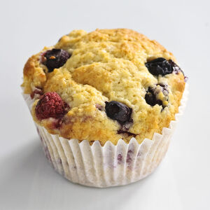 MIxed berry muffin with blueberries and raspberries in paper case credit: Marie-Louise