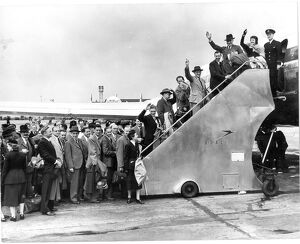 Passengers for the worlds first jet airliner service are shepherded aboard the BOAC