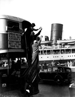 The public waving off a ship from a passing bus