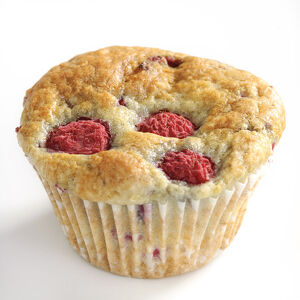 Raspberry muffins on white background credit: Marie-Louise Avery / thePictureKitchen