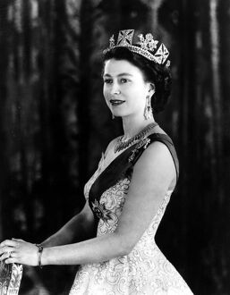 A Royal Command Portrait at Buck Queen Elizabeth II wearing an evening gown with