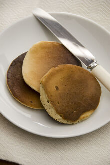 Three Scotch pancakes on a white plate. credit: Marie-Louise Avery / thePictureKitchen