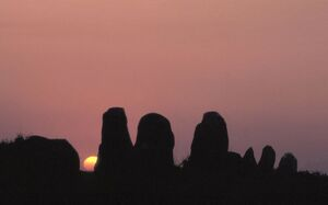 Silhouette of the Carnac landscape: alignments of menhirs at sunrise, Morbihan, Southern