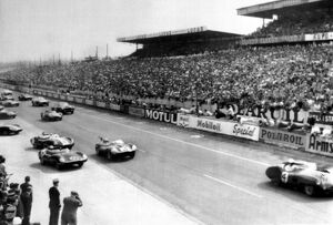 At the start of the Le Mans Grand Prix, British racing driver Stirling Moss leads