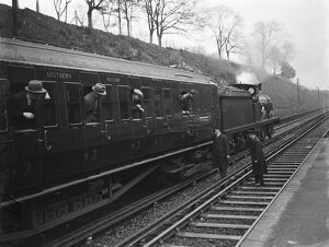 Testing electrified railway lines by steam train in Swanley , Kent . 1938