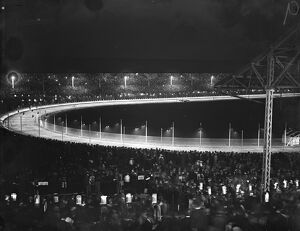 The White City at night, where illuminated greyhound racing attracts average crowd of 75,000