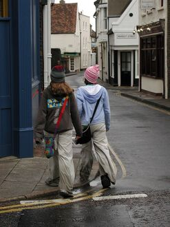 Young fashion: two teenage girls wearing baggy trousers that drag on the ground