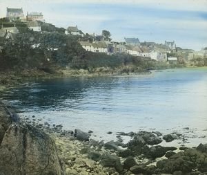 Coverack from across the beach at high tide, Cornwall. Around 1925