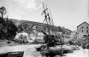 A schooner and other boats, East Looe Quay, Looe, Cornwall. Around 1890