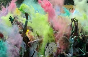 COLOURED POWDER THROW DURING THE FESTIVAL OF COLOURS IN ST
