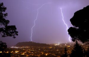 A flash of lighting lights up the sky above the 'Baie des Anges' in Nice