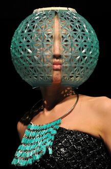 A model displays a creation by Kyrgyz designer Abylkasym kyzy Gulburak during Bishkek