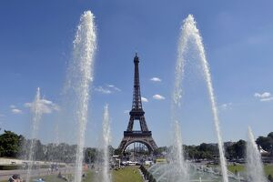 A picture shows a general view of the Eiffel tower on a warm and sunny day on July 3