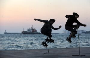TWO SKATERS JUMP ON THE SEVASTOPOL EMBANKMENT