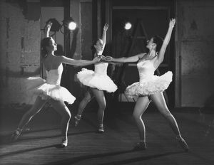 Three ballerinas in white tutus. Across the Frontiers, 1952.