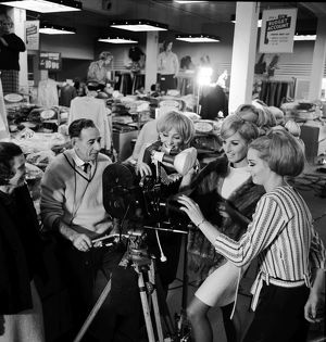 Models and a camera. Case for Books, The. 1966.