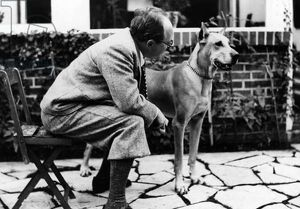 Portrait of German writer Paul Eipper with his dog (b/w photo)