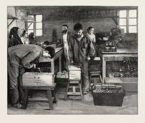 DYNAMITE MANUFACTURE AT ISLETEN, NEAR FLUELEN, SWITZERLAND: PACKING THE CARTRIDGES