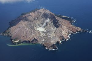 Aerial view of White Island volcano with central acidic crater lake, Bay of Plenty