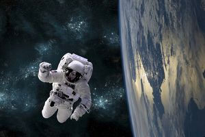 An astronaut floating above Earth
