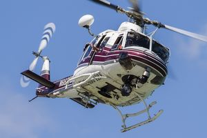 A Bell 412 helicopter flies along the Chicago lakefront