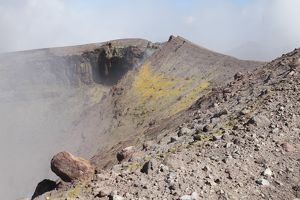 Degassing North crater with fumarolic sulphur deposits. Mount Etna volcano, Sicily, Italy