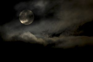Harvest Moon through clouds