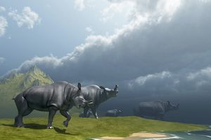 A herd of Brontotherium dinosaurs come to the lake to drink