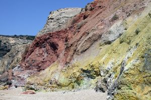 Hydrothermally altered red and yellow cliffs with fresh fumarolic deposits, Greece