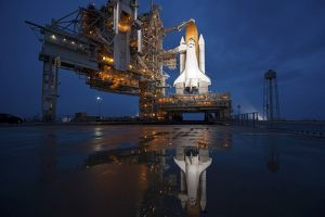 Night view of space shuttle Atlantis on the launch pad at Kennedy Space Center, Florida