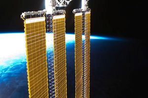 A partial view of International Space Station solar panels and Earth's horizon