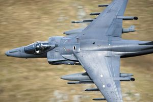 A Royal Air Force Harrier GR9 flying low over North Wales