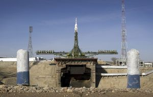 The Soyuz rocket is erected into position at the launch pad at the Baikonur Cosmodrome