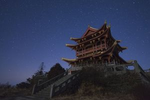 Stars of the Big Dipper and constellation Leo shine above a temple of Mount Emei in China