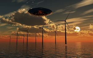 A UFO flying above an ocean wind farm at sunset