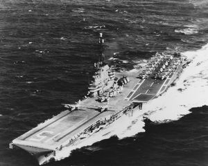 USS Randolph underway at sea with two S2F airplanes on its catapults, 1962