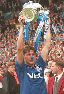 Duncan Ferguson of Everton holds the FA Cup above