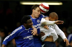 Chelsea's Terry challenges Everton's Vaughan during their English Premier