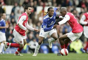 Everton v Arsenal Manuel Fernandes in action with Francesc Fabregas and Vasiriki