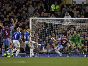 Everton v Aston Villa Lee Carsley - Everton shoots at goal under pressure from Liam
