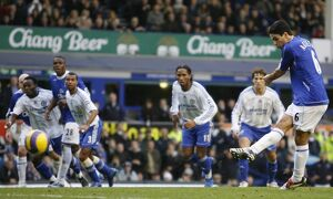 Everton's Arteta scores a penalty against Chelsea during their English Premier