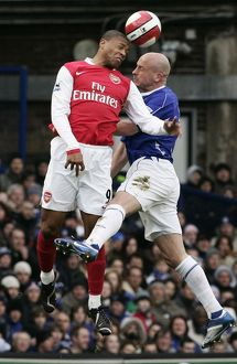 Everton's Carsley challenges Arsenal's Baptista for the ball during their