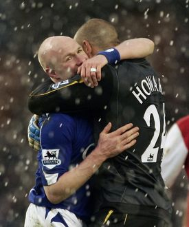 Everton's goalscorer Johnson celebrates with Tim Howard
