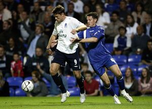 Everton's James Beattie and Peterbrough's Mark Arber in action