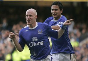 Everton's Johnson celebrates with Cahill after scoring during their English Premier