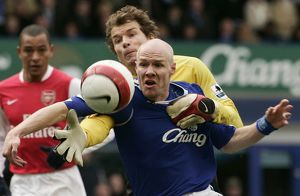 Everton's Johnson challenges Arsenal's Lehmann for the ball during their