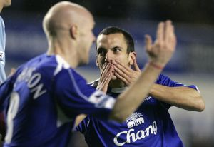 Everton's Osman celebrates with Johnson after scoring during their English Premier