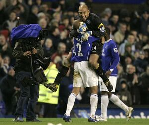 James Vaughan celebrates with Tim Howard